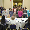 Students work on picking out a place to live on the money their career choses pay them at the CU4 Reality event on Tuesday at the DoubleTree by Hilton in Leominster. A collaboration of credit unions have spent the school year working with Fitchburg, Leominster, Ayer and Clinton schools on a budgeting program based on career choices. On Tuesday they held an event for the students to put what they learned to uses and see if they could live on a budget. SENTINEL & ENTERPRISE/JOHN LOVE