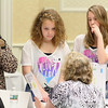 Sydney Mullen, 13, and Kiara Wilbur, 13, seventh graders at the Memorial Middle School in Fitchburg talk with Cindy Bundy about insurance as they try and prepare a budget at the CU4 Reality event on Tuesday at the DoubleTree by Hilton in Leominster. A collaboration of credit unions have spent the school year working with Fitchburg, Leominster, Ayer and Clinton schools on a budgeting program based on career choices. On Tuesday they held an event for the students to put what they learned to uses and see if they could live on a budget. SENTINEL & ENTERPRISE/JOHN LOVE