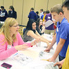 Ryan Dupell, 13, and Jaden Hamilton, 13, eighth grader at the Ayer Shirley Middle School work with Deb Parson to pick out a place to live on the money their career choses pay them at the CU4 Reality event on Tuesday at the DoubleTree by Hilton in Leominster. A collaboration of credit unions have spent the school year working with Fitchburg, Leominster, Ayer and Clinton schools on a budgeting program based on career choices. On Tuesday they held an event for the students to put what they learned to uses and see if they could live on a budget. SENTINEL & ENTERPRISE/JOHN LOVE