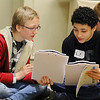 Cory Kozloski, 13, and Lorenzo Budryk, 13, seventh graders at the Memorial Middle School in Fitchburg compare their budgets at the CU4 Reality event on Tuesday at the DoubleTree by Hilton in Leominster. A collaboration of credit unions have spent the school year working with Fitchburg, Leominster, Ayer and Clinton schools on a budgeting program based on career choices. On Tuesday they held an event for the students to put what they learned to uses and see if they could live on a budget. SENTINEL & ENTERPRISE/JOHN LOVE