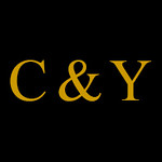 CY text logo reversed gold text