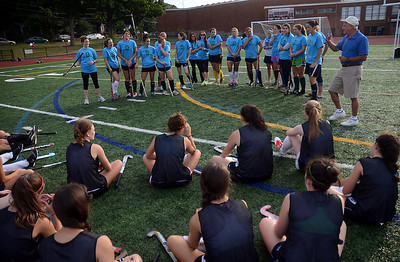7/20/12 Dedham- Former Dedham High School Head Coach, Frank Barbuto, introduces alumni to the Dedham High School field hockey team during Friday afternoon's Alumni game. Photo by Sean Browne, Dedham Transcript