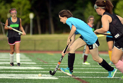 7/20/12 Dedham- Colleen Burbank controls the ball during the Dedham girls field hockey team's end during Friday afternoon's Alumni game. Photo by Sean Browne, Dedham Transcript