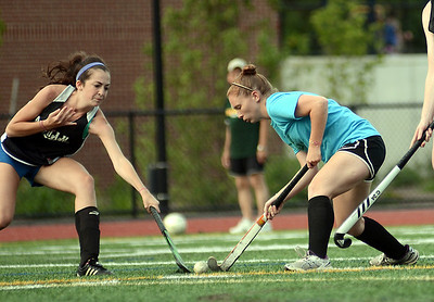7/20/12 Dedham- Dedham's Jenny Boudrow attempts to get the ball into scoring position against the Dedham girls field hockey team's defense during Friday afternoon's Alumni game. Photo by Sean Browne, Dedham Transcript