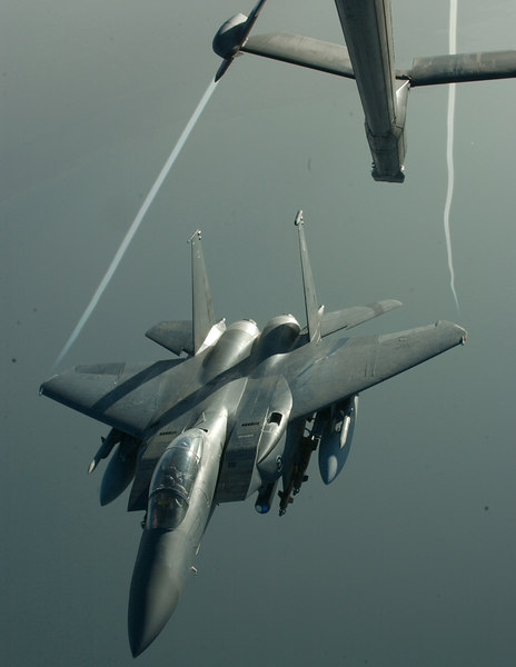 An F-15 Strike Eagle flies veers  off in the early evening light after receiving fuel from a 908th Expeditionary Air Refueling Squadron KC-10 during a recent mission over Iraq. Coalition aircraft average 40 combat sorties daily in the skies over Iraq in support of Operation Iraqi Freedom.<br /> US Air Force Photo by TSgt. Erik Gudmundson