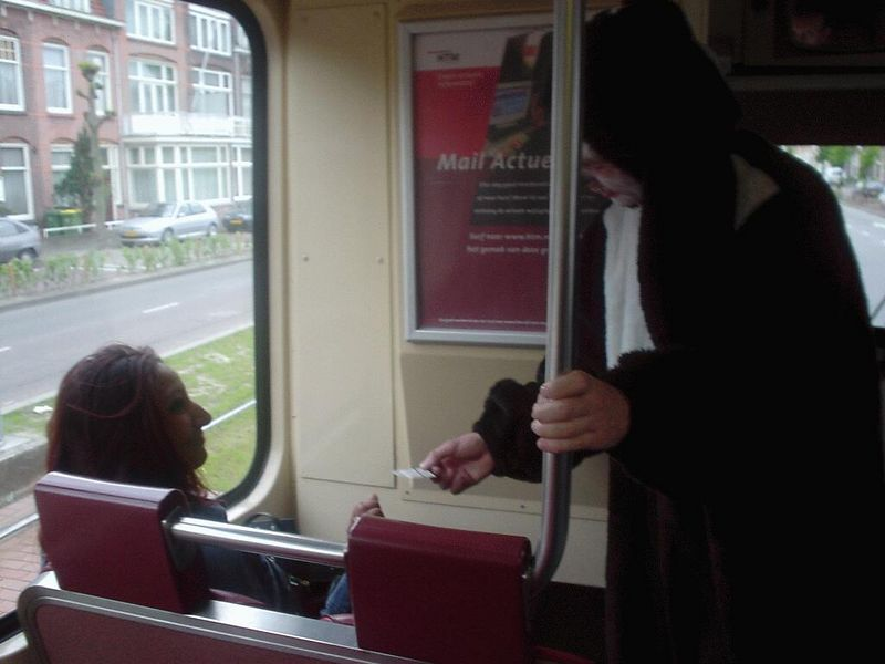 Yves 1st job: check the tix of people on the tram