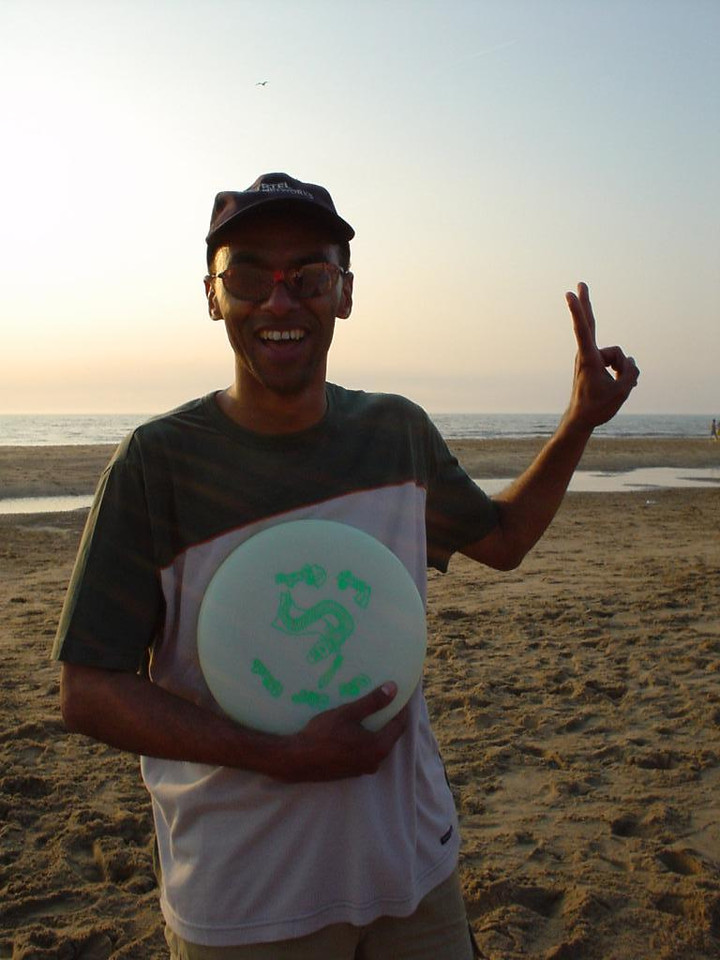 Played frisbee on the beach! Woohoo! Here's Madou with my glow-in-the-dark frisbee and the dorky sunglasses he found in the sand.