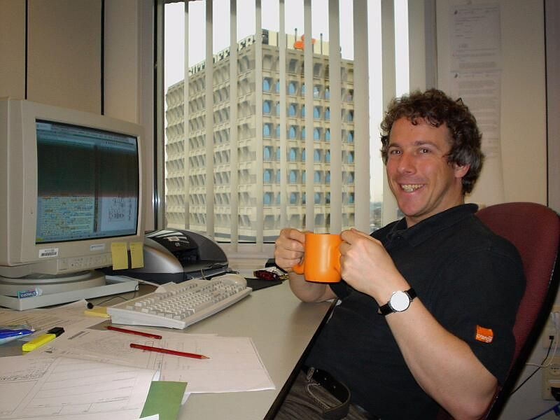 Me in my office with my prior art coffee mug (March 2003), given to me by my friend Juli
