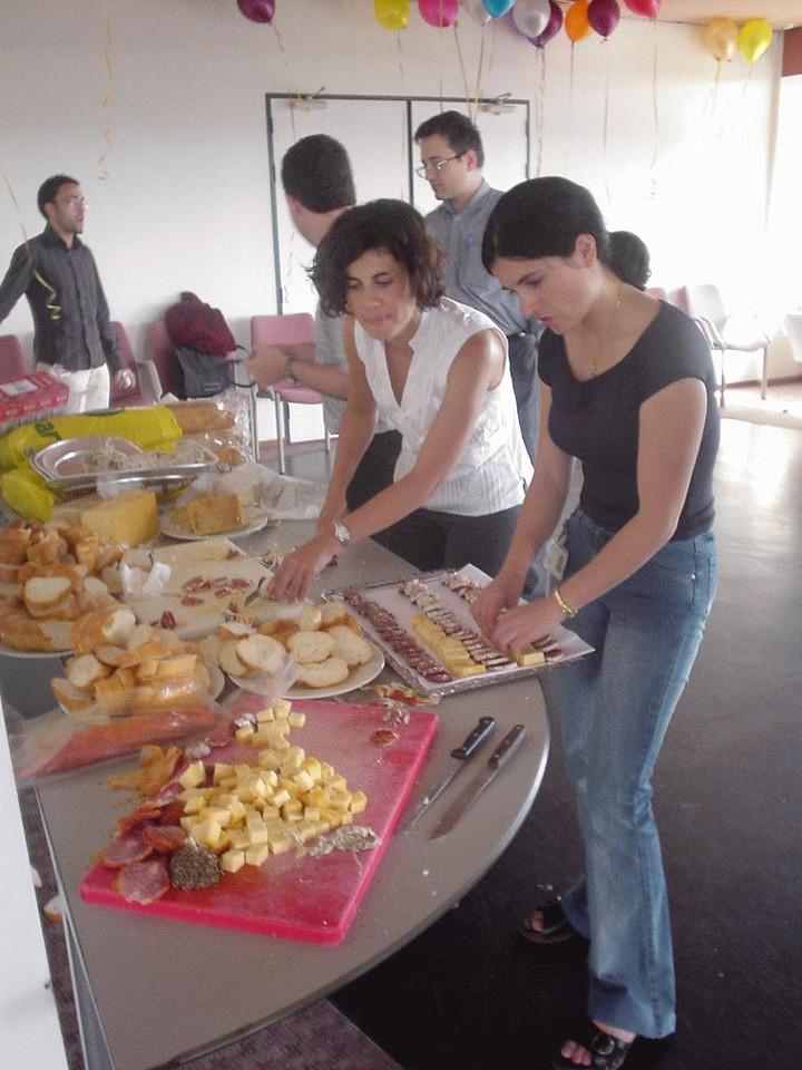 Girls (Cristina and Victoria) cutting bread
