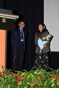 Prof SK Cheong with a bunch of flower for Prof Gracie Ong, widow of the late Prof John Bosco