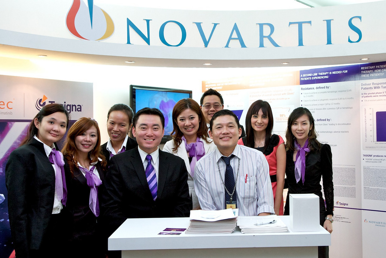 Dato' Dr Chang visiting the Novartis booth, one of our platinum sponsors.