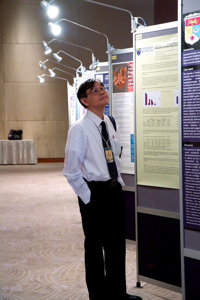 Day 2, 30th April 2011. Prof Sk Cheong doing some judging on the posters.