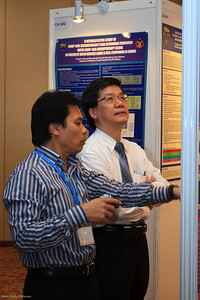 Prof Aziz Baba and Dr Ng Soo Chin judging the posters