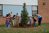 Tree is planted at Gaithersburg Elementary School to honor former principal Sharon Jones on Arbor Day.