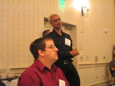 Satnam asks a question (or two) while Kyle looks on.