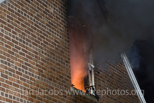 "Working still alarm at 11128 S. Ave. ""C"" in Chicago; a 2 story ordinary, 25X30. Companies responding: E104; T61, 34, 17; 23rd, 24th Battalion Chiefs; TL 34, & RIT (rapid intervention team), Sq 5 (recalled). At bottom right hand corner of window is what appears to be a pike pole, a device used to explore any available space and occasionally remove hazardous objects. Now the thing is... there is a firefighter on the other end of it."