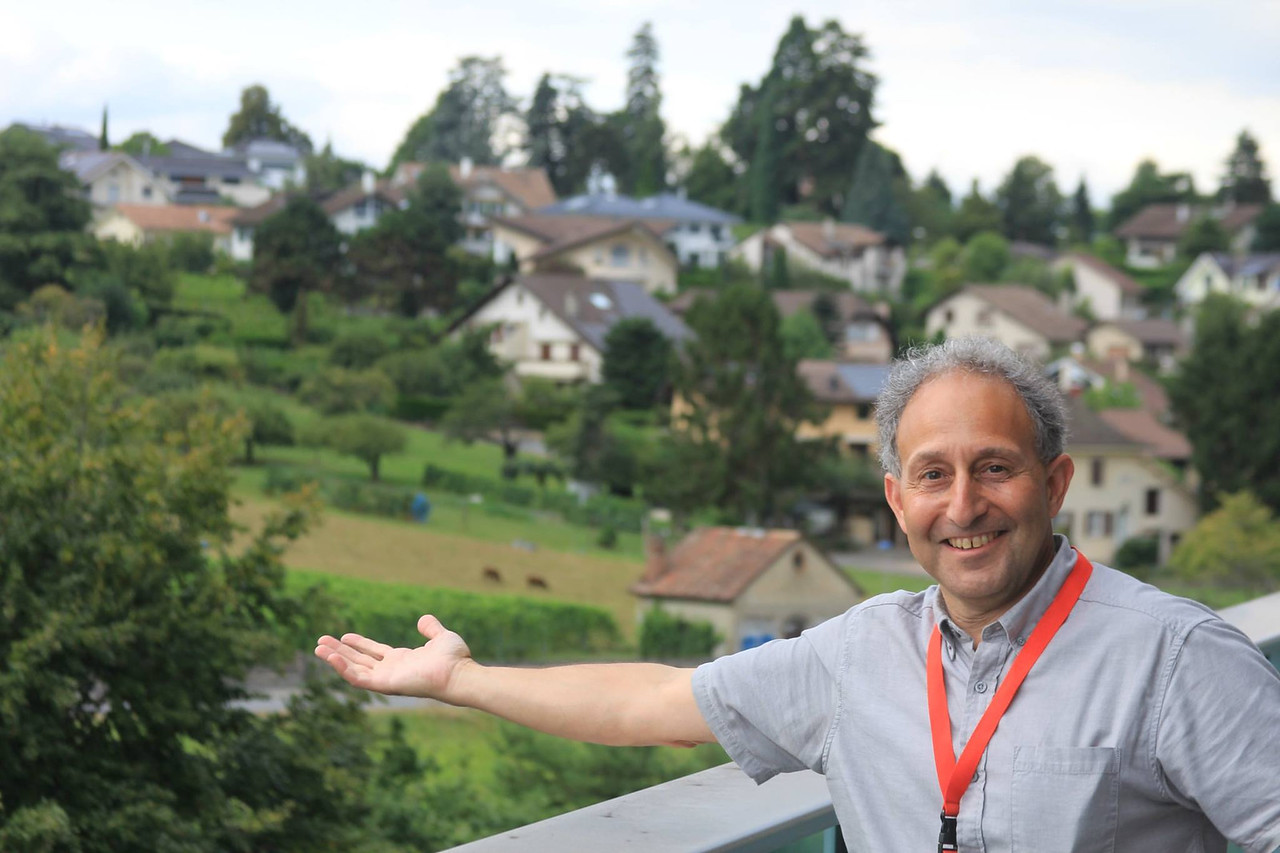 Shep urges you to buy one of his many cottages in the Swiss suburbs