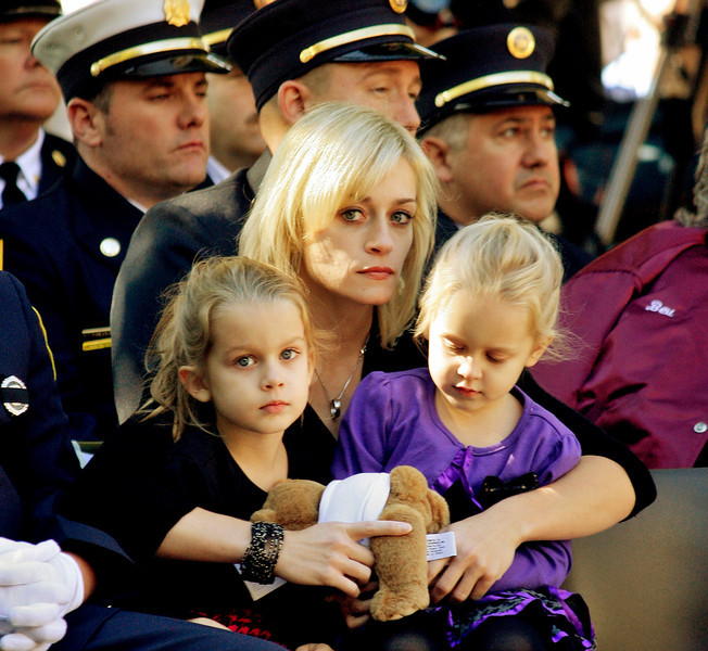Mike McMahon - The Record, Kimberly Chiapperini holds her daughters Kacie and Kylie during a ceremony at the New York State Fallen Firefighters Memorial on Tuesday, Oct. 8, 2013, in Albany, N.Y. Chiapperini's husband Michael was one of two West Webster Fire Department members whose names were added to the memorial during a ceremony honoring firefighters who died in the line of duty. The West Webster firefighters were killed in a Christmas Eve ambush last year.The New York State Fallen Firefighters Memorial at the Empire State Plaza.