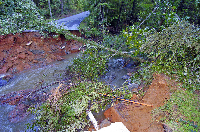 Tall Pines Road in  Fairfield Plantation was washed out due to the same viloent flood waters that devastated residents and took lives in Paulding, Douglas, Cobb and some portions of Villa-Rica as well as other counties across the South East. <br /> PHOTO BY JOE LIVINGSTON/STAFF