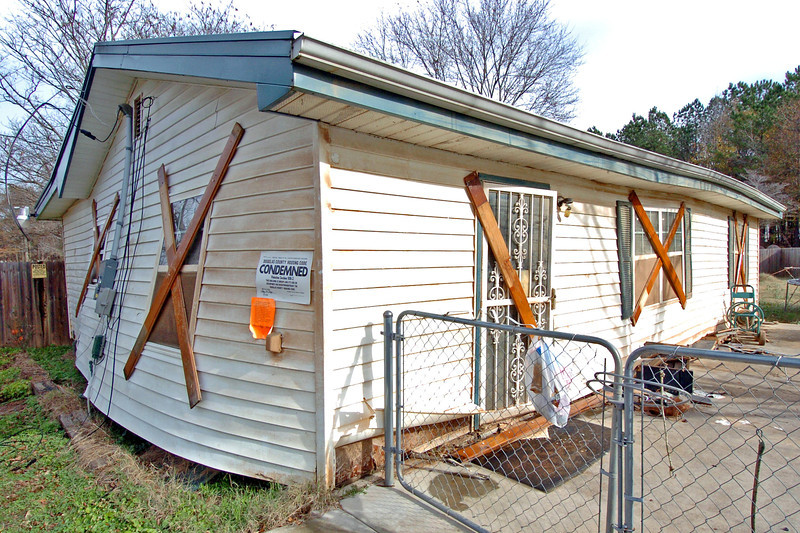 This condemed home was washed sevral feet off its foundation by floodwaters up to the roof.