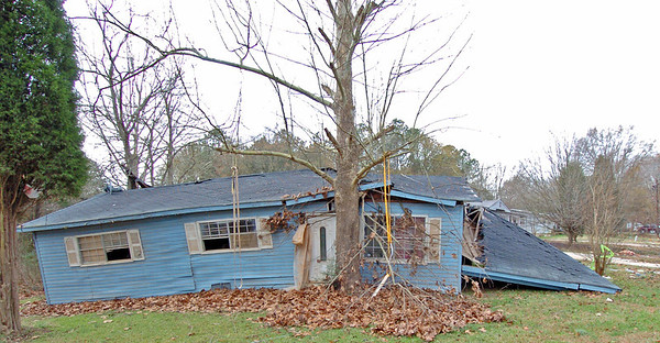 This home was lifted off its foundation and slammed into trees stopping it from washing farther downstream by the powerful flood waters of Sweetwater Creek.