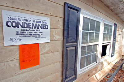 """One of the hundreds of """"Condemed"""" signs in this Sweetwater Creek Subdivision. You can see the bricks that were once part of the foundation before floodwaters washed it several feet back."""