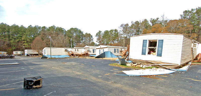 Floodwaters turned this mobile home park into a condemed area that looks like a war zone.