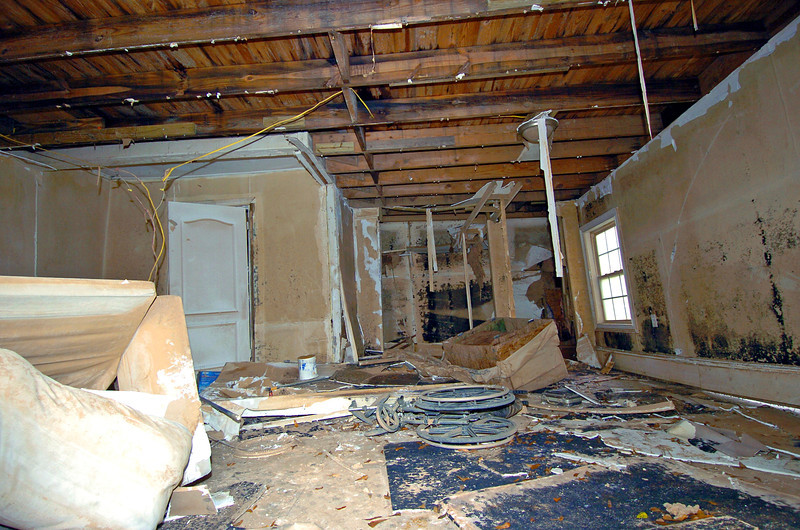 A Couch, Love Seat and Wheel Chair sits in what used to be a Great Room of a home along Sweetwater Creek, the flood waters were too much for this subdivision causing 3/4 of all its homes to be destroyed and/or condemed.