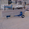 3 Wheel Pinch Dolly<br /> Part Number 52031<br /> This unique design uses a weight/pinching mechanism to hold pieces of material securely in place.  Carpeted cradle and rubber pinchers prevent marring of your finished product.  The nose piece extends to 72 inches (182.88 cm).  Pneumatic tires add stability to one end, while a fully pivoting caster on the other end allows this dolly to move with ease around the shop or job site.  Unit has a weight capacity of 700 lbs. (317.51 kg).