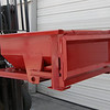 Dump Hopper.  Part Number 52530.  Ideal for containment of scrap pieces of any kind, this unit makes it safe and easy to transport large quantities from point A to point B.  Hands free operation.  Dumps when forks are tilted.  Holds up to 1 ton.  .4 cubic yard capacity.  Two safety chains.  formed steel and welded construction.  PPG coating (Rust-resistant paint).