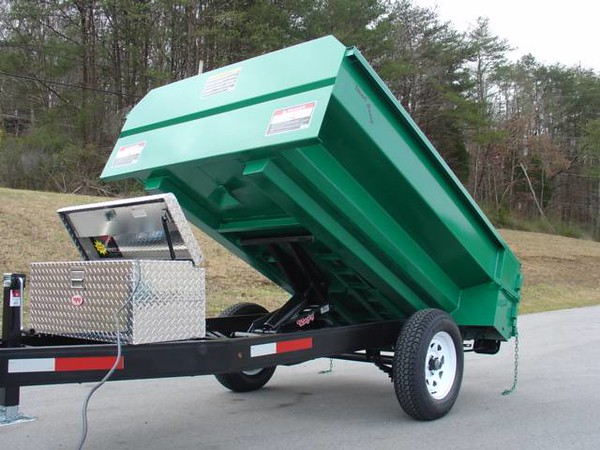 Note tunnel construction under bed for high strength and light weight. Clamshell hydraulics don't hang down below frame. Trailer is the same width as conventional pickup truck. Can charge battery from truck if desired.