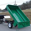 Dumps like a dumptruck; raises to 45 degrees. Unique tub design is patent-pending.