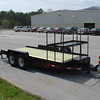 Bobcat trailer with shelf for extra bucket.