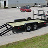 Skid-steer trailer.