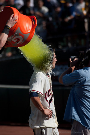 Josh receives a Gatorade Shower after scoring the winning run at the Oakland A's vs. Seattle Mariners Throwback game on July 8, 2012.