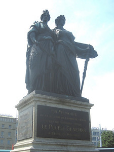 """Monument in the English Garden, the figures """"Helvetia"""" and """"Geneva"""" commemorating Geneva's 1814 entry into the Confederation (""""Switzerland"""" is technically the """"Confederation Helvetic"""")"""