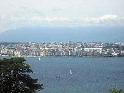 """From left to right--Geneva and the Rhone River--panorama #1  The panorama that follows has a """"story""""--the pics are taken from Cologny, a village overlooking Geneva and the birthplace of """"Frankenstein""""!  In 1816, Lord Byron and Mary Shelley, staying in villas near this spot, gathered one wintry night and made a bet:  who could write a horror (horrific?) story most quickly?  One year later, in England, Mary Shelley's """"Frankenstein"""" was published."""