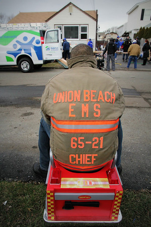 EMS Chief Carlos Rodriguez looks on as volunteers from NBC Today join Habitat for Humanity to help repair his family's Union Beach, N.J., home that was damaged during Hurricane Sandy. ©Photo by Habitat for Humanity International/Scott Umstattd