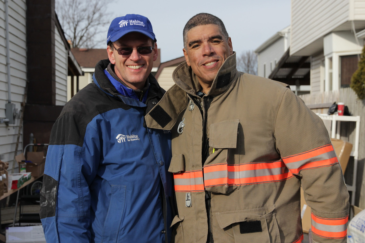 Habitat for Humanity International CEO Jonathan Reckford stands with homeowner and EMS Chief Carlos Rodriguez on December 20, 2012. Habitat for Humanity and NBC Today staff spent the day helping to repair Rodriguez's home that was flooded by Hurricane Sandy. ©Habitat for Humanity International/Scott Umstattd