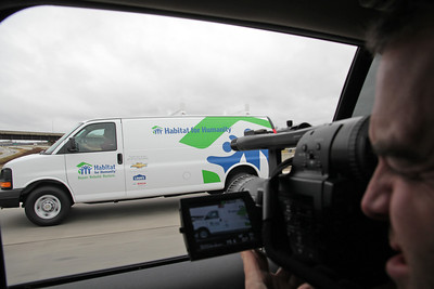 Habitat for Humanity International videographer Andrew LaFontaine documents Habitat's first Mobile Response Unit as 24 vans loaded with tools and volunteers travel from Atlanta to New York and New Jersey on December 17, 2012 to rebuild after Hurricane Sandy. ©Habitat for Humanity International/Scott Umstattd