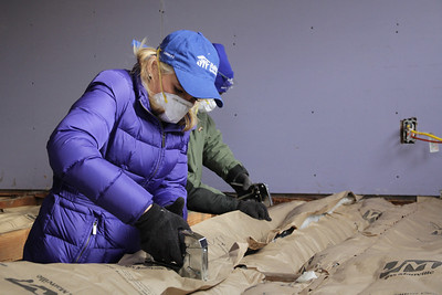 NBC News correspondent and Habitat for Humanity volunteer Andrea Manning secures insulation in the floor boards of the Rodriguez home in Union Beach, New Jersey on December 20th, 2012. NBC staff and crew volunteered with Habitat for Humanity to help rebuild in the aftermath of Hurricane Sandy. ©Habitat for Humanity International/Scott Umstattd