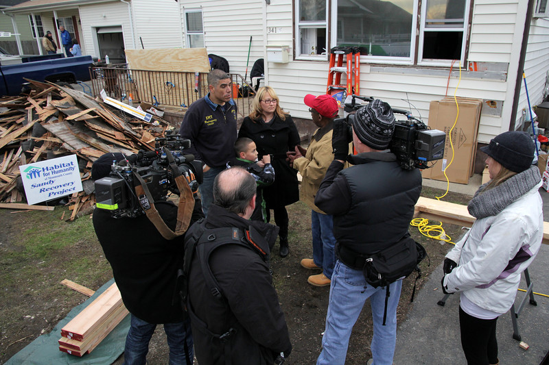 NBC Today films outside the home of Carlos and Dawn Rodriguez on December 20, 2012. NBC staff volunteered on this day to help rebuild the Rodriguez home with Habitat for Humanity after Hurricane Sandy. ©Habitat for Humanity International/Scott Umstattd