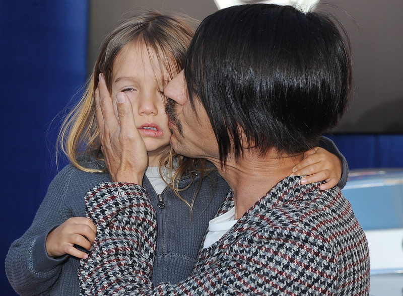 """Anthony Kiedis, and his son, Everly arrive at the world premiere of  """"Cars 2"""" at El Capitan Theater  in Los Angeles, Saturday, June 18, 2011.  The film will be released June 24 . (AP Photo/Katy Winn)"""