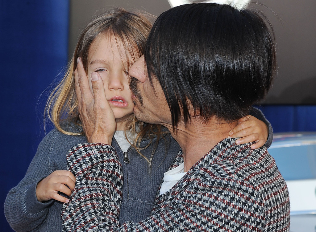 "Anthony Kiedis, and his son, Everly arrive at the world premiere of  ""Cars 2"" at El Capitan Theater  in Los Angeles, Saturday, June 18, 2011.  The film will be released June 24 . (AP Photo/Katy Winn)"