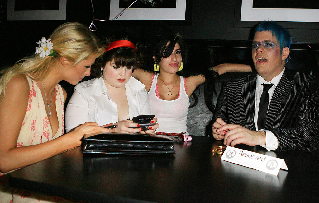 WEST HOLLYWOOD - MARCH 23: (L to R) Paris Hilton, Kelly Osbourne, Amy Weinhaus, and Perez Hilton attend Perez Hilton's Birthday Party At The Roxy, March 23, 2007 in West Hollywood, California. (Photo by Getty Images for Perez Hilton)