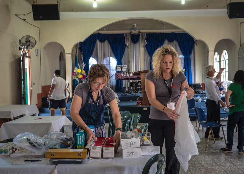 Team Leader, Kelly Hardiman (left), and Erin Hardiman prepare for a full day of eye exam and eyeglass fittings.