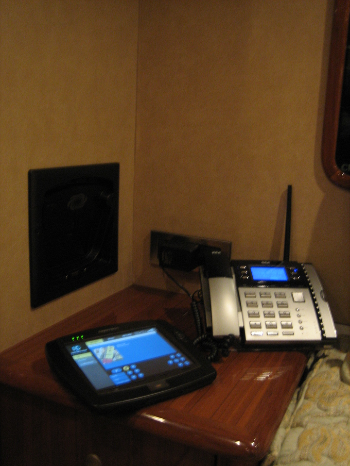"The in wall docking station for the Crestron 8.4"" remote panel offers a safe and secure charging and storage solution. The panel retains full functionality even when stowed in the dock. This photo is in a Master Stateroom."