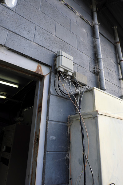 Repaired phone interface box on outside of building