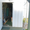 Access door to power panels and storage container interior