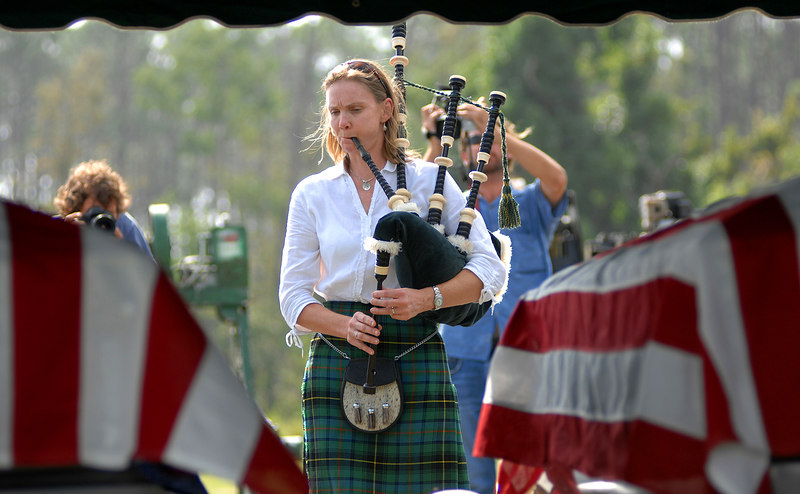 Rachel Benefield-Pfaff of Gulfport plays the bagpipes during a ceremony to lay to rest the last two unidentified victims of Hurricane Katrina at the Pineridge Memorial Cemetery in Gulfport Tuesday.